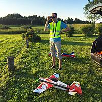 """Name: fpv-late.jpg Views: 92 Size: 265.4 KB Description: Me watching FPV on quadrocopter... My RC Factory / Twisted Hobby's 39"""" EPP 540 Edge on the foreground."""
