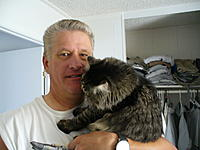 Name: P1050823.jpg Views: 211 Size: 131.8 KB Description: He loved to be held and would always want to be picked up and huged. If I hadn't shaved in a day or so he would love to have a good face rub on my day old wiskers.