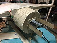 Name: D4DB6A6E-FE40-467D-BEEF-175DD7C2EC37.jpeg Views: 13 Size: 1.99 MB Description: Planking complete to nose and engine mount installed on 5 degree plywood wedge to offset the engine for P factor