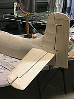 Name: D045A9D9-591A-4DE8-87E3-53A06AA10EAD.jpg Views: 8 Size: 3.37 MB Description: Top and Blocks fitted and sanded to rudder. My sons Durafly 1100mm Skyraider is in the background