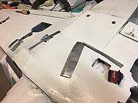 Name: 3B65ED79-C67B-4FD7-BBC0-FBFAA943EA8E.jpeg Views: 0 Size: 1.59 MB Description: Servo fitting. Left flap servo prepped for install. Far left of shot the right aileron servo has been installed