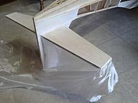Name: 20190609_184538.jpg Views: 16 Size: 130.3 KB Description: 3/4 oz. fiberglass cloth -- 1st coat polycrylic I am covering all wood not covered with solartex with fiberglass cloth and polycrylic -- start in middle and move to edges insuring no wrinkles