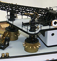 Name: bibs.jpg Views: 22 Size: 418.9 KB Description: Revell includes the covered hose bib stations, but I had to rework them with turned spigots and HO hand wheels.