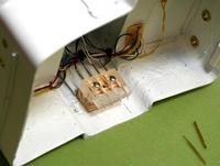 Name: yf_1262.jpg Views: 531 Size: 43.5 KB Description: Pogo block mounted in cabin... see the little guys sticking out?