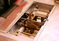 Name: a_2068.jpg Views: 470 Size: 77.8 KB Description: All that mechanism to work the two pins (they rise out of the deck and rotate, for line control)