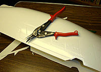 Name: a2-01419.jpg Views: 801 Size: 126.0 KB Description: Using aviation snips to trim the hull.
