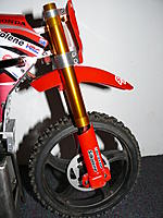 Name: SR4 WORKS PIG 238.JPG Views: 154 Size: 824.4 KB Description: Once again way to long  for a stock SR4 , these proto's were cut 10 mm shorter , I now cut them to 20 mm shorter ,  for the best over all length .  If I want to Motard or flat track , I just raise them in the triples  to lower the ride height on front end