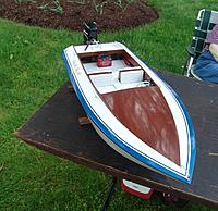 Name: BOW SHOT.jpg Views: 116 Size: 990.2 KB Description: The typical SKI BOAT design with a the richness of mahogany, what's not to like.