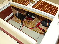 Name: Rear seat removed.jpg Views: 64 Size: 2.70 MB Description: In this photo the rear seat has been removed to  gain access to the working lighting battery box and on/off switch, steering servo and linkage to the rudder, the electronic air horns sound package, and the radio receiver, Velcro'ed high on the transom.