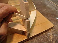 Name: DSC04424.jpg Views: 367 Size: 51.6 KB Description: Checking with the batten material for the correct depth of the notch so that the face of the batten will be flush at the center of the stem post.