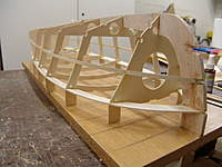 Name: DSC04426.jpg Views: 387 Size: 71.1 KB Description: With the batten glued to the stem post, proceed to glue the batten at each of the frames in it's notch, all the way to the transom.