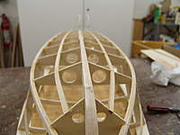 Name: DSC04430.jpg Views: 322 Size: 47.4 KB Description: With both bottom battens glued in place, you are ready to use a sanding block to true up the frame work for the sub-planking.