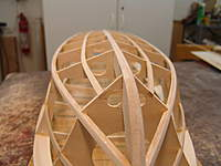Name: DSC04434.jpg Views: 304 Size: 49.8 KB Description: Wioth the sanding block sand the chines and the keel true to the frames and battens.