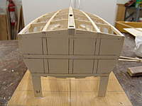 Name: DSC04431.jpg Views: 318 Size: 59.0 KB Description: With all the transom over hangs trimmed and sanded smooth, you are ready to glue the radius timbers to the transom were laser marked.