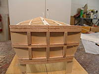 Name: DSC04440.jpg Views: 318 Size: 60.8 KB Description: The radius timbers and the vertical blocking timbers are glued in place were laser marked on the transom.