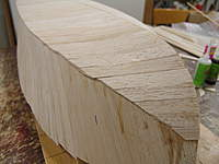 Name: DSC04457.jpg Views: 341 Size: 60.7 KB Description: The planking continues to the bow and the turn of the stem post.  Angle sanding of the butt joint is nessary for a good fit here. notice that the bottom planking starts over lapping the side planking going to the stem post.