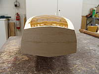 Name: DSC04466.jpg Views: 345 Size: 64.4 KB Description: After the top of the balsa transom is glued in place, the transom is block sanded true with the sides, bottom of the hull, and top of the lite ply transom to the shears.