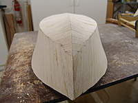 Name: DSC04467.jpg Views: 358 Size: 50.9 KB Description: Block sanding at the stem of the hull back into the run of the planking you can see why the hull will plane off so easily.