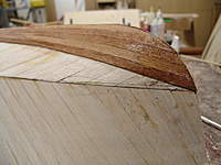Name: DSC04477.jpg Views: 352 Size: 77.5 KB Description: With the chined line penciled on the hull, we can proceed to plank for a total of 9 planks on each side.