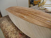 Name: DSC04483.jpg Views: 347 Size: 75.7 KB Description: The bottom plaking is trimmed and block sanded smooth with the side of the hull.