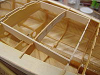 Name: DSC04580.jpg Views: 242 Size: 60.7 KB Description: The hatch frames, HF, are glued into their slots in frames #F5, #F6, and #F7A with medium CA glue. Glue on the outsides of the hatch frames.