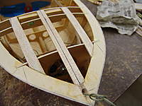 Name: DSC04611.jpg Views: 282 Size: 70.7 KB Description: The bow light wire is run up thru the oversized drilled hole in the stem post. (Picture was taken after the deck battens were installed)