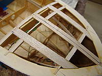 """Name: DSC04612.jpg Views: 252 Size: 74.2 KB Description: After the deck battens wer glued in place, additional gluing blocking was glued in front of the frames in between the deck battens using the 1/4"""" x 1/4"""" balsa."""