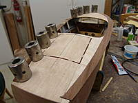Name: DSC04638.jpg Views: 364 Size: 75.9 KB Description: Covering boards being installed onto the sub decking.  The right side is alrady glued in place.  The left side has had the butt splice joint at the bow block sanded for a good fit and is now being glued in position.