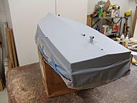 Name: DSC04755.jpg Views: 359 Size: 59.4 KB Description: The bottom of ther hull was taped off at the water line and sprayed with three good primer coats.