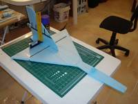 Name: DSC00298.jpg Views: 336 Size: 76.2 KB Description: Gluing in the vertical stab. The rudder won't be operational on this one.