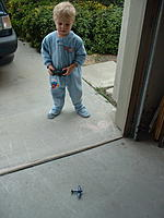 Name: 2005_0210_093634AB.jpg Views: 91 Size: 147.2 KB Description: My son (trying to copy what Dad does) with his die-cast Corsair.  He was saying up...up...
