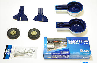 E-flite 60-120 size 95 degree strut ready rotating main retract system, and E-flite 60-120 F4U shock-absorbing strut set provided for this review. The wheels, gear doors, and wheel well liners are included with the kit.