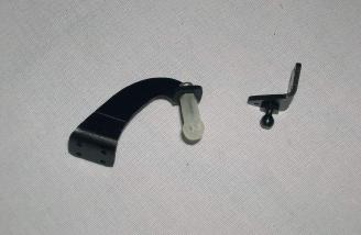 The two main assemblies for the landing gear door hinges. These must be assembled from the parts shown.