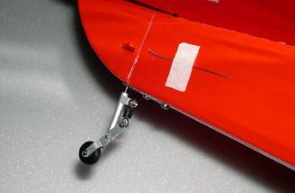 Tail wheel attached to fuselage.