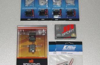 Spektrum Ar6200 receiver, (4) E-flite S75 sub-micro servos, JR sport MC35 micro servo, and (2) lightweight 9 inch aileron extensions.