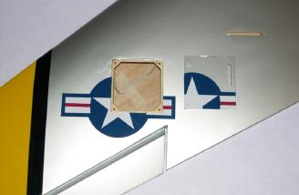 Wood servo covers are included for the bottom of the wing, but are not used for the recommended servos. Note: Factory installed pull string for the aileron servo wire.