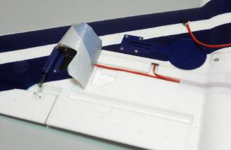 Molded flap servo pocket shown under self adhesive tape-like covering.