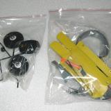 Fixed landing gear, fin mounting plates, exhaust nozzle, and misc. supplies.