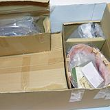 Smaller sub-assemblies and accessories packed in smaller boxes within the kit box.
