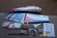 Name: DCP_2266.jpg Views: 989 Size: 94.0 KB Description: All the parts in the box layed out for you to see, sorry I ripped off the foam covering over the cowl.
