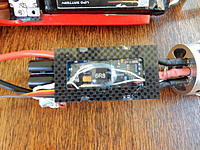 Name: DSCN1365.jpg Views: 78 Size: 773.7 KB Description: 1mm CF mount for speed control. 4 slots for zip ties and centre cut out to provide better clearance between LiPo and SC Heat Sink.