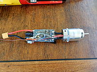 Name: DSCN1367.jpg Views: 89 Size: 1.13 MB Description: Removed shrink wrap. cut off side covering heat sink.  Soldered RPM wires onto the motor leads.  Wrapped Temp sensor 1 around motor.  Sat Temp sensor 2 on SC Circuit board.  Gooped wires down & taped remaining shrink wrap on top, then left to set.