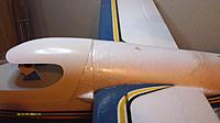 Name: IMAG0009.jpg Views: 107 Size: 118.2 KB Description: Wing mounted with clear tape over seam to keep any spray out.