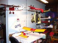 Name: Hangar Garage  1.jpg Views: 113 Size: 82.7 KB Description: Forground planes. Closest is Fokker VII, Inverted plane is Tiger Moth 400 and on table the Stevens Stik Extreme