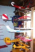 Name: Hangar Garage  5.jpg Views: 81 Size: 86.5 KB Description: Top to Bottom Fokker DR-1, Soar Stik, Cessna 180, 1morestik, Tiny Tiger Moth
