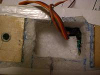 Name: CIMG0799.jpg Views: 148 Size: 54.3 KB Description: This is after I stuffed a piece of EPP in to protect the receiver and servo extensions.