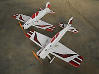 Name: DSCN2348 (640x480).jpg Views: 206 Size: 184.7 KB Description: Fancy Foam Fenix v2 Plane on left is depron, plane on right is EPP painted using createx paint and posterboard templates