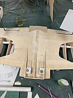 I also got a trick I cut out the wing bolt holes on the plastic fairing and glued them in place. It will Finnish the fairing nicely. I used paper templates to mark and cut the parts to size.