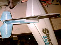 Name: PICT0014.jpg Views: 597 Size: 62.6 KB Description: Glue the wing to the rest of the fuselage. Check that the horizontal is parallel to the wing. Glue the remaining tail stiffener to the bottom of the wing. I had to trim them just a hair to the edge to the aileron slot to clear the aileron. I also tacked t