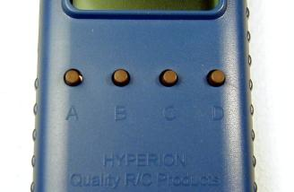 "Closeup of the user interface - four buttons marked ""A"", ""B"", ""C"" and ""D"". Each is assigned a function according to what's going on at the time, with labels on the bottom line of the display."